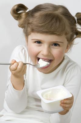 bigstock-Cute-girl-eating-yogurt-16361657.jpg